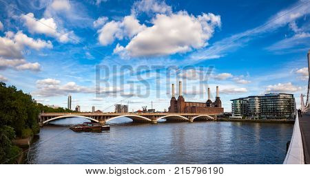 Historical shot of decommissioned coal-fired Battersea power station, located on the south bank of the River Thames in South West London, England and Grosvenor Bridge as viewed from the Chelsea Bridge