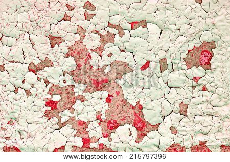 Texture background - light red peeling paint on the old rough concrete texture surface. Texture of peeling paint closeup, peeling paint texture surface. Red peeling paint texture background, closeup of peeling paint.