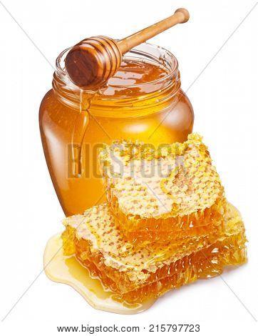 Jar full of fresh honey and honeycombs isolated on white background.