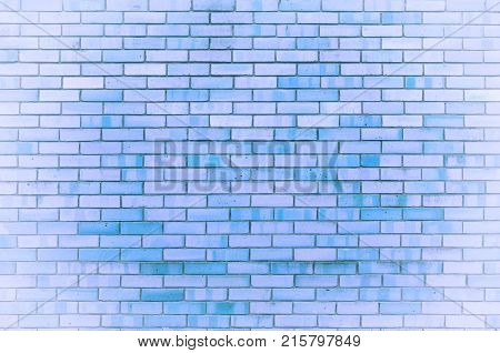 Stone texture background of blue brick wall texture with stone bricks. Closeup of stone bricks, texture background of stone wall made of bricks. Stone bricks background
