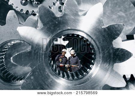 Industry-workers, engineers standing inside a giant steel shaft, steel industrial concept