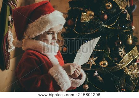 Santa Claus Kid At Christmas Tree.