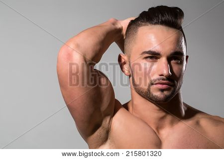 Coach sportsman with bare chest. Sport and workout. Dieting and fitness. Man with muscular body and torso. Athletic bodybuilder man on grey background.
