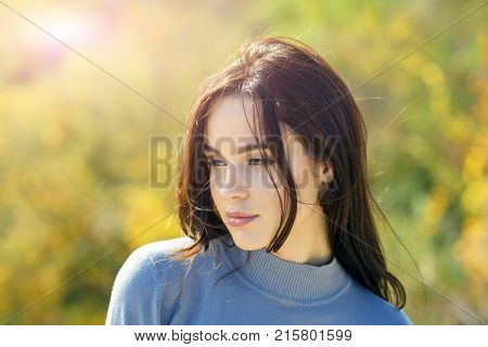 Skincare youth health. Girl with long brunette hair enjoy autumn nature. Woman face with makeup on sunny day. Cosmetics visage make up. Fashion beauty concept.