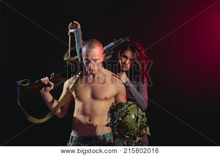 boyfriend and girlfriend isolated on black war. military man and girl with naked body. Relations of soldier couple with gun. couple in love of sexy man and woman fight. Love sex games revolution.