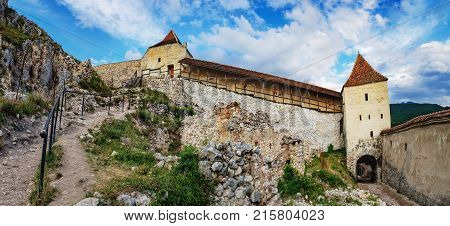 Panoramic view of the inner courtyard of the Rasnov Fortress under cloudy sky, Rasnov city, Brasov county, Romania