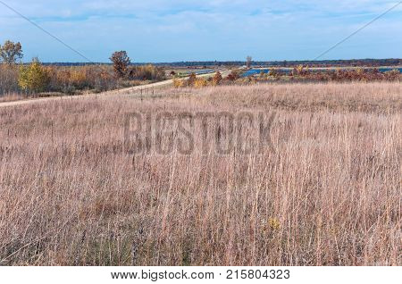 road through prairie and wetlands of necedah national wildlife refuge in central wisconsin