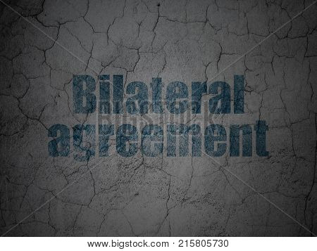 Insurance concept: Blue Bilateral Agreement on grunge textured concrete wall background