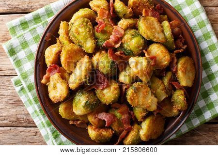 Roasted Brussels Sprouts In Breadcrumbs With Crispy Bacon Close-up On Plate. Horizontal Top View
