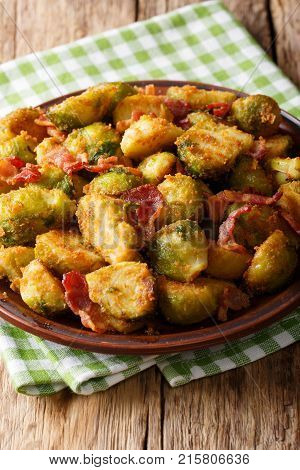 Organic Food: Fried Brussels Sprouts In Breadcrumbs With Bacon Close-up On. Vertical