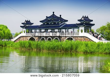May 16 2015. Lake Tai China. Chinese tourists walking across the bridge of meeting fairy on Lake Tai or Taihu in Wuxi China in Jiangsu province.