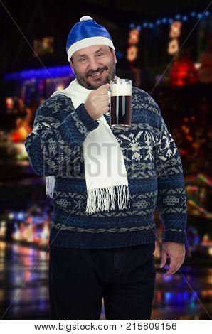 Beer Lover Holds Dark Beer Pint