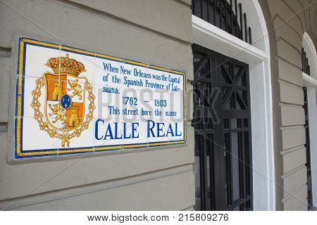 NEW ORLEANS - MAY. 29, 2017: Royal Street Sign with historic road name as Calle Real in Spanish in French Quarter in New Orleans, Louisiana, USA.