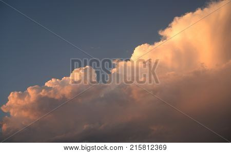 Pink clouds in a storm sky background