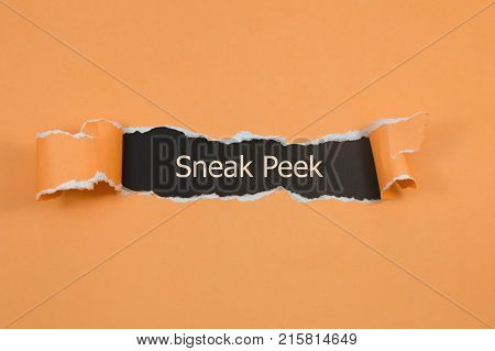 The phrase Sneak Peek appearing behind torn yellow paper.