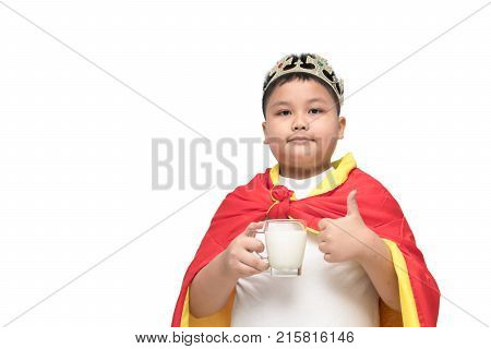 cute obese boy is showing his thumb up with milk in hand; isolated on the white background background with copy space for input text