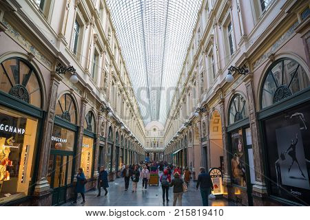 Brussels, Belgium - April 22, 2017: People shop in the historical Galeries Royales Saint-Hubert shopping arcades in Brussels