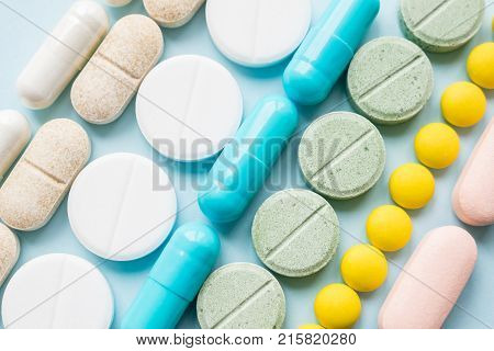 Opioid painkillers crisis and drug abuse concept. Opioid and prescription medication addiction epidemic. Different kinds of multicolored pills. Pharmaceutical medicament background