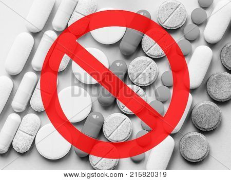 Stop Opioids. Painkillers crisis and drug abuse concept. Opioid and prescription medication addiction epidemic. Different kinds of multicolored pills. Pharmaceutical medicament background