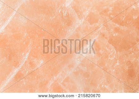 Pastel pink cream delicate texture from rose quartz. Geological mineral background. Big salt crystal