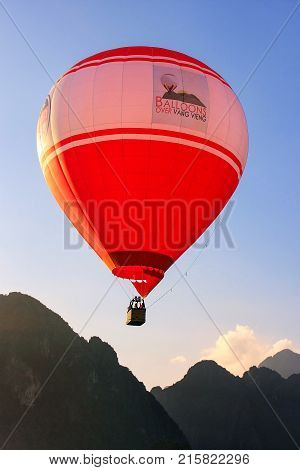 VANG VIENG LAOS-NOVEMBER 27: Hot air balloon flying in early morning on November 27 2011 near Vang Vieng Laos. Vang Vieng is popular destination for adventure tourism in a limestone karst landscape