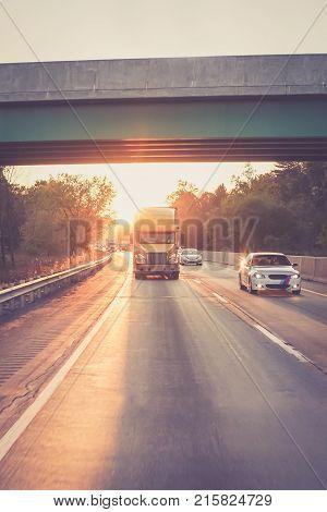Yellow 18 wheeler semi trucks on highway road