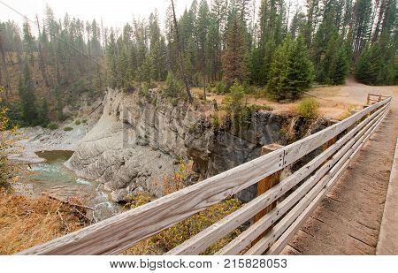 Wooden Bridge over Meadow Creek Gorge for hiking and horseback packing trail in the Bob Marshall Wilderness   poster