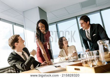 Diverse Business People Smiling During A Meeting