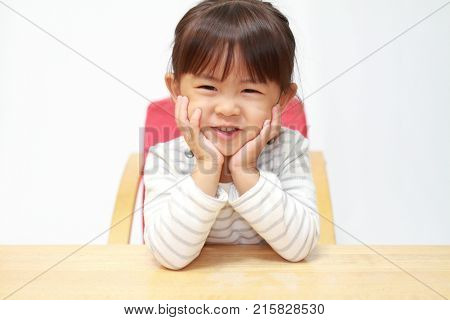 Japanese Girl Resting Her Chin In Her Hands (3 Years Old)