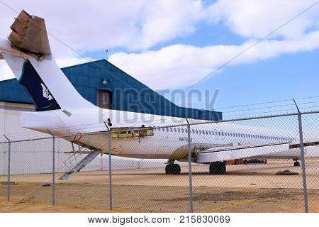 November 27, 2017 in Victorville, CA:  Forgotten airliner aircraft scrapped for parts at an airplane boneyard in Victorville Airport, CA where airlines retire their older aircraft and where aviation enthusiasts can see these planes upfront and personal