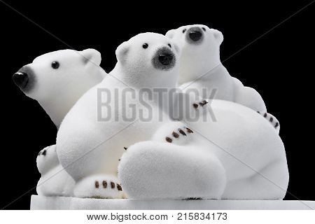 Christmas And New Year Decorations: Figurines Of A White Polar Bear With Cubs. Isolated, Black Backg
