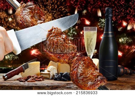 Delicious barbecue of picanha celebrating the end of the year with fireworks and champnhe
