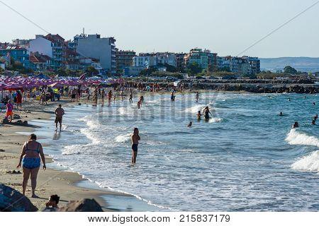 POMORIE BULGARIA - AUGUST 26 2017: View of the public beach on the the seaside town of Pomorie on the Black Sea Bulgarian Black Sea Coast.
