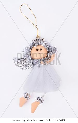 Silver Christmas angel figurine. Handmade vintage Christmas white angel decoration isolated on white background. Chistmas holiday concept.