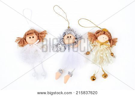 Collection of Christmas angels figurines. Three cute Christmas angels decorations isolated on white background. Christmas holidays ornaments.