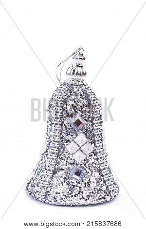 Christmas silver bell decoration. Silver stones Christmas bell decoration isolated on white background studio shot. Luxury Christmas ornamental bell.