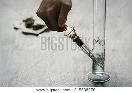 Bong and medical marijuana, cannabis thc flower Sativa and Indica Close up on a black background. lifestyle Concepts the legalization of marijuana in the world
