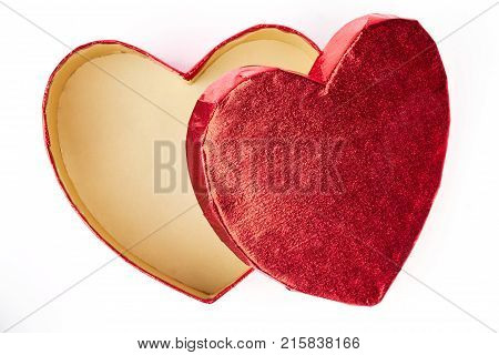Open empty heart-shaped gift box. Elegant red gift box in a shape of heart isolated on white background. Container for Chrisrtmas decorations.