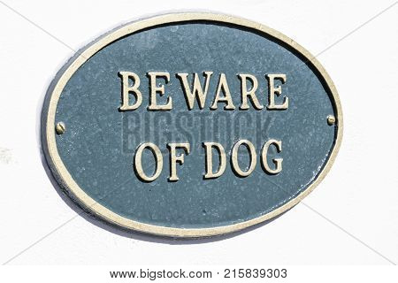 Close up shot of a beware of dog sign on a white background