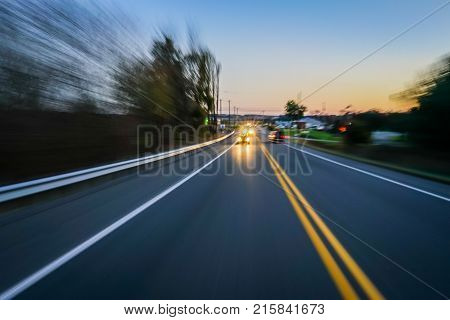 Car driving at night with motion blur