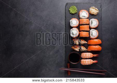 Sushi Set Sashimi With Salmon, Shrimp, Eel And Sushi Rolls Philadelphia Served On Stone Slate. Top V