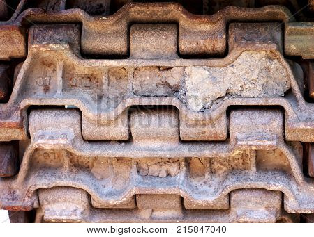 Abstract image of tank tracks. Tank tread tires. Steel textured tire tracks. Military transportation. Military vehicle tires. Steel texture.