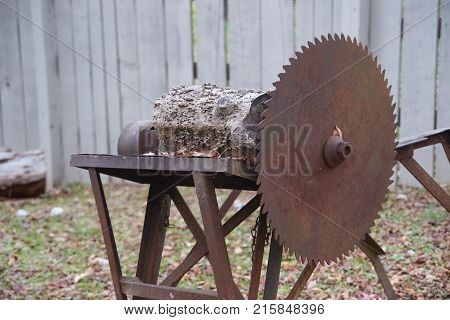 Old ta table saw with wood being cut