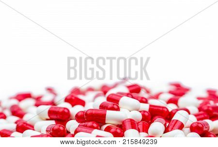 Selective focus of antibiotic capsules pills on white background with copy space. Drug resistance concept. Antibiotics drug use with reasonable and global healthcare concept.