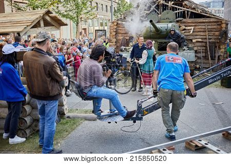 MOSCOW, RUSSIA - SEP 10, 2017: Group of cinematographers shooting a movie episode with legendary T-34 tank on Tverskaya Street during celebration 870th anniversary of Moscow.