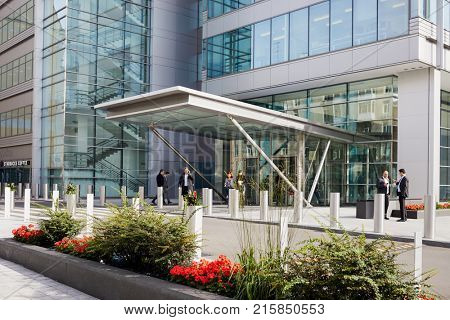MOSCOW, RUSSIA - SEP 20, 2017: People outdoors at entrance of Ducat Place III - one of the most famous and high-quality office centres in Moscow.