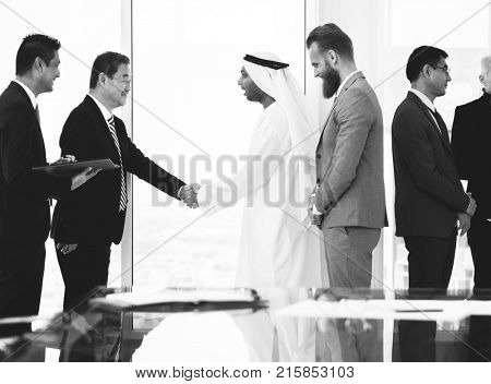 Middle eastern business man having a hand shake with an Asian businessman