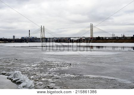 Cable stayed bridge on the outskirts of St. Petersburg at winter day Russia. poster