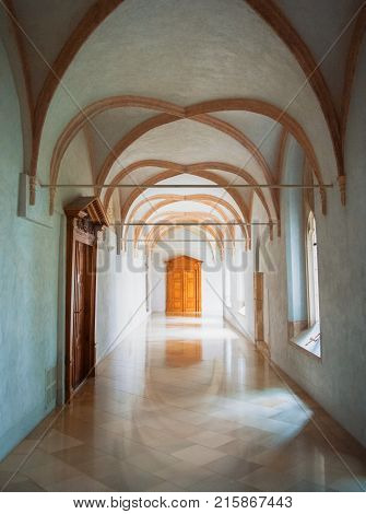 Pannonhalma, Hungary - July 28, 2016: Whote Gothic Corridor And A Bright Wooden Door At Pannonhalma