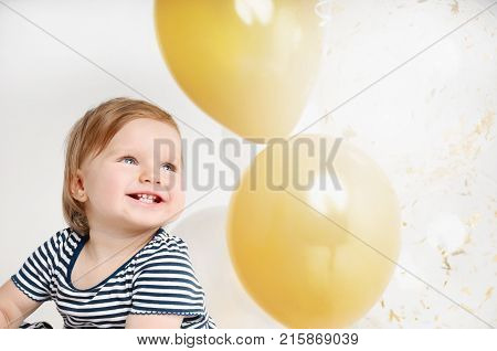 Happy And Smiling One Year Old Baby Portrait With Balloon Background